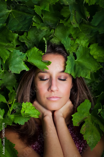 close-up portrait of young beautiful women in leafs