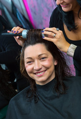 stylist making woman new hairstyle