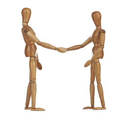 Wooden dummies shaking hands, Cooperation of business