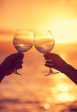Man and woman clanging wine glasses with champagne at sunset dra poster