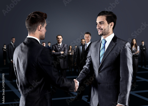 Portrait of young business people. Handshake