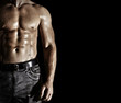 Bodybuilder posing on the black background