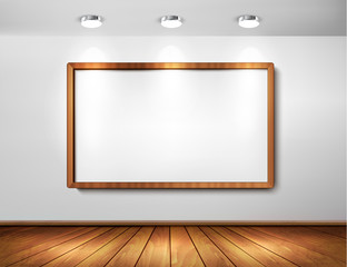 Empty wooden frame on wall with spotlights and wooden floor.