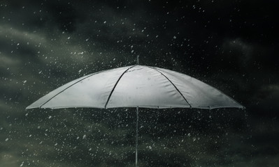 Umbrella in thunderstorm