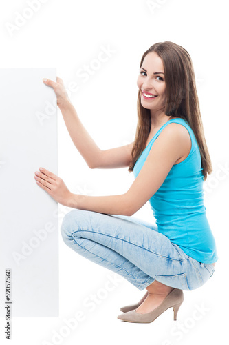 Woman crouching by blank board