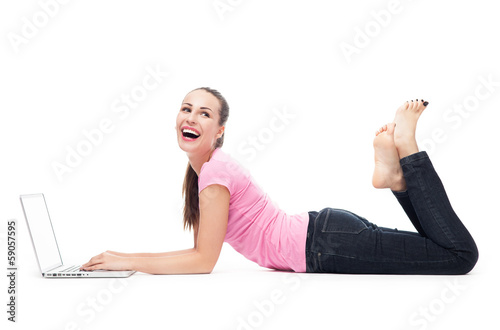 Woman with her laptop lying on the floor