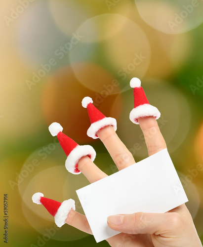Hand holding clear New Year card