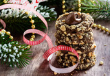 Chocolate filled cookies with hazelnuts, festive decorations