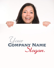 Close-up shot on a smiling brunette holding a blank signboard