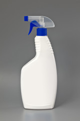 White detergent plastic spray bottle Isolated on gray