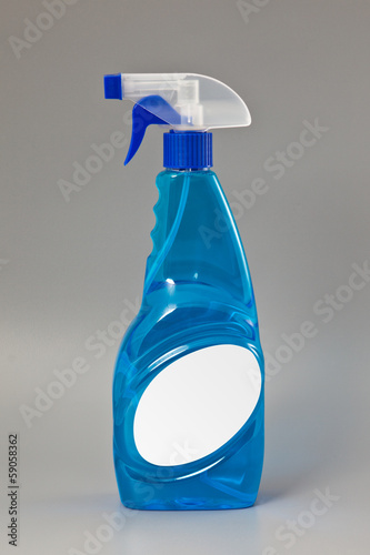 Blue transparent detergent spray bottle Isolated on gray