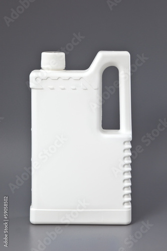 White detergent plastic bottle isolated on gray