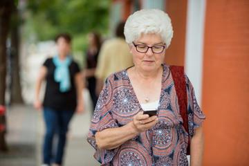 Senior Woman Messaging On Smartphone