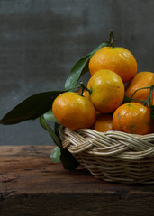 Still life with  tangerines  in  basket