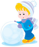 Child with a big snowball for a snowman