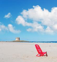 chair under clouds in La Pelosa