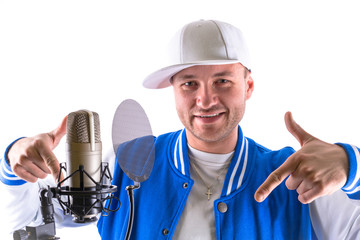 Young man with microphone and headphones over white