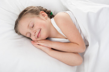 cheerful girl sleep in white bed