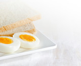 Boiled egg and toasts on white plate