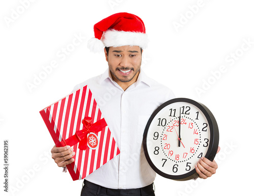 Christmas man holding gift box, clock, running out of time
