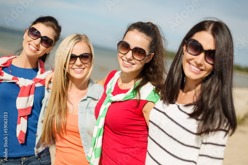 beautiful teenage girls having fun on the beach