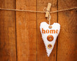 heart hanging on wooden background
