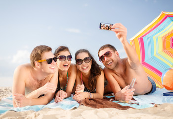 group of people taking picture with smartphone