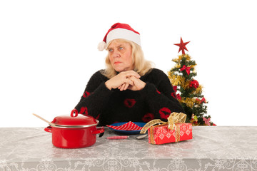 Woman of mature age alone with Christmas