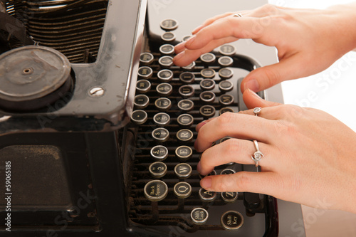 Writing with old black typewriter