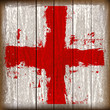 Grunged English Cross of Saint George Flag over a wooden plank
