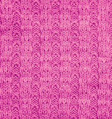 pink knitted fabric as a background. macro