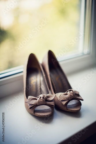 Women's shoes on the windowsill