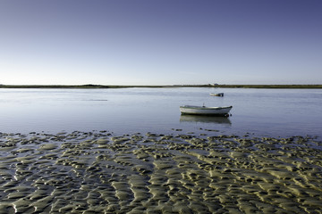 Tidal flat with a small boat