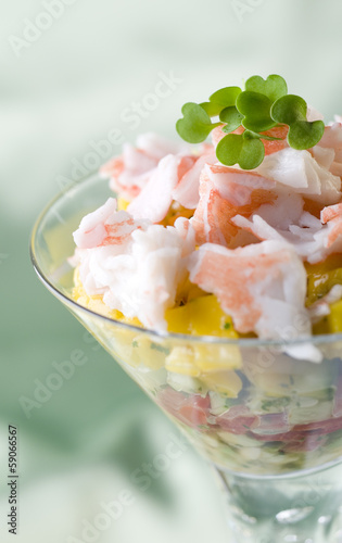 crab salad appetizer with fruits and vegetables.