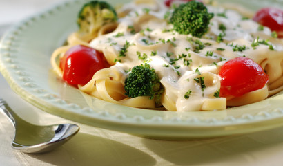 pasta Alfredo with red peppers and broccoli.