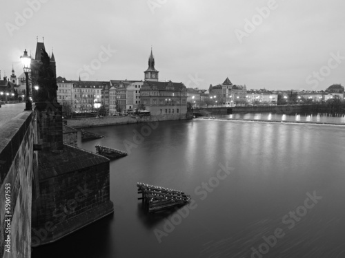 Autumn Charles bridge in the morning fog, Prague