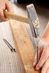 Hammer and nail woodworking