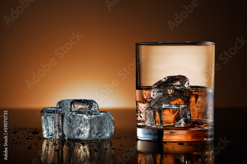 Whiskey glass with warm background