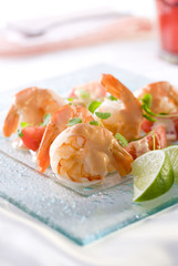 shrimp salad with cocktail sauce, tomatoes and microgreens