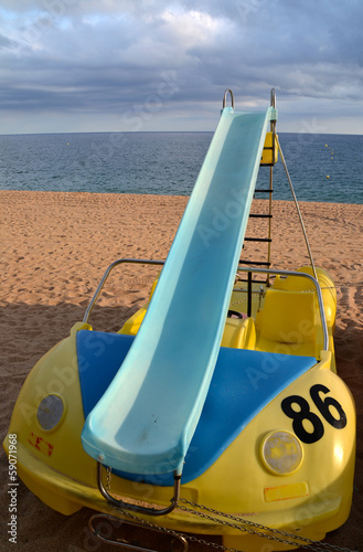 Colorful pedal boat for rent on the beach