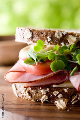 Closeup of a fresh ham and cheese sandwich.
