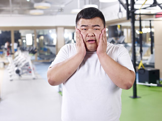 overweight man  in gym