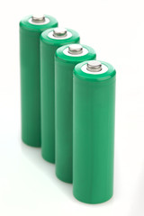 Four green batteries with blank covers