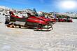 Snowmobiles sun snow