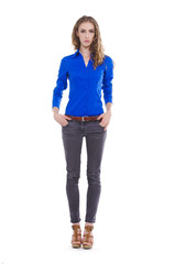 Full body fashion model in jeans standing posing