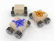 three Brown cardboard boxes with wheels