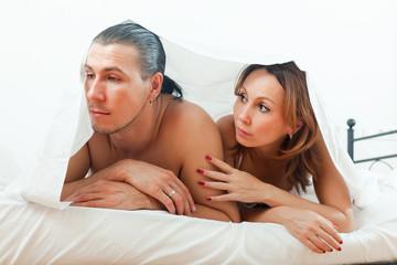 Unhappy man has problem under sheet