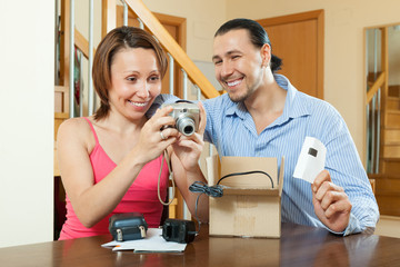 couple with new compact digital camera