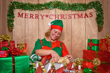 An elf wrapping Christmas presents in the North Pole