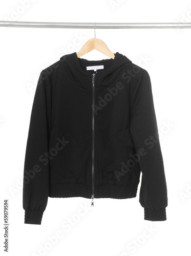 Women black jacket hanging on hanger on white background